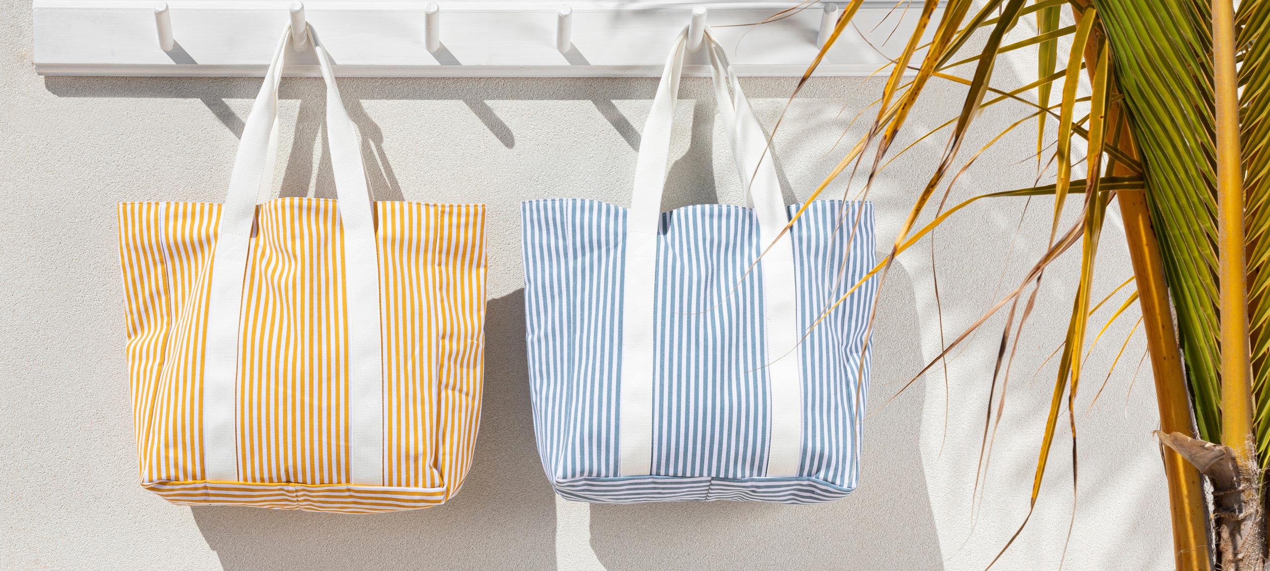 Yellow and blue striped beach bags