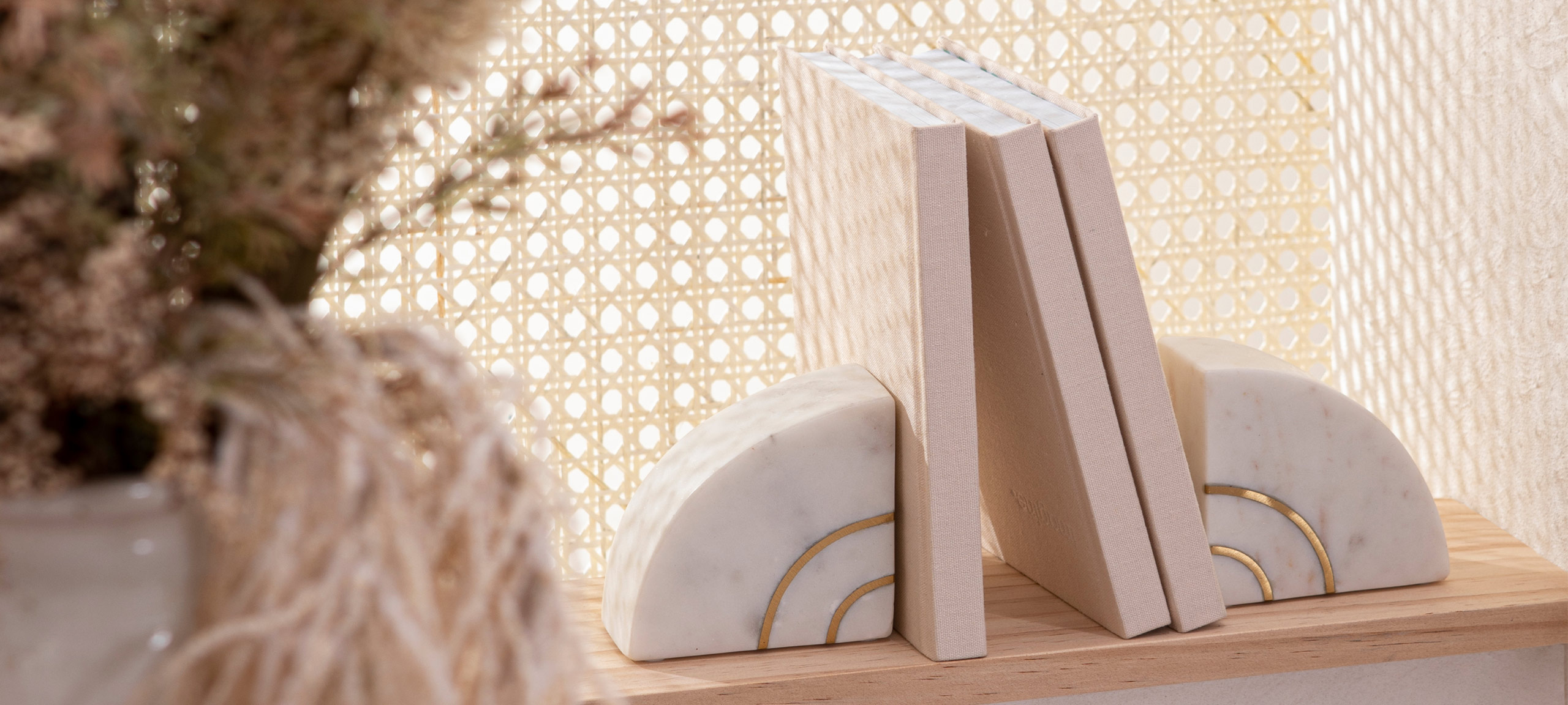 2 marble bookends featuring gold detailing