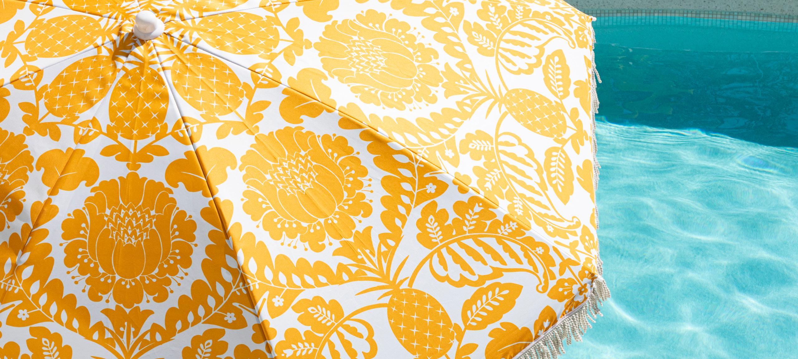yellow printed beach umbrella