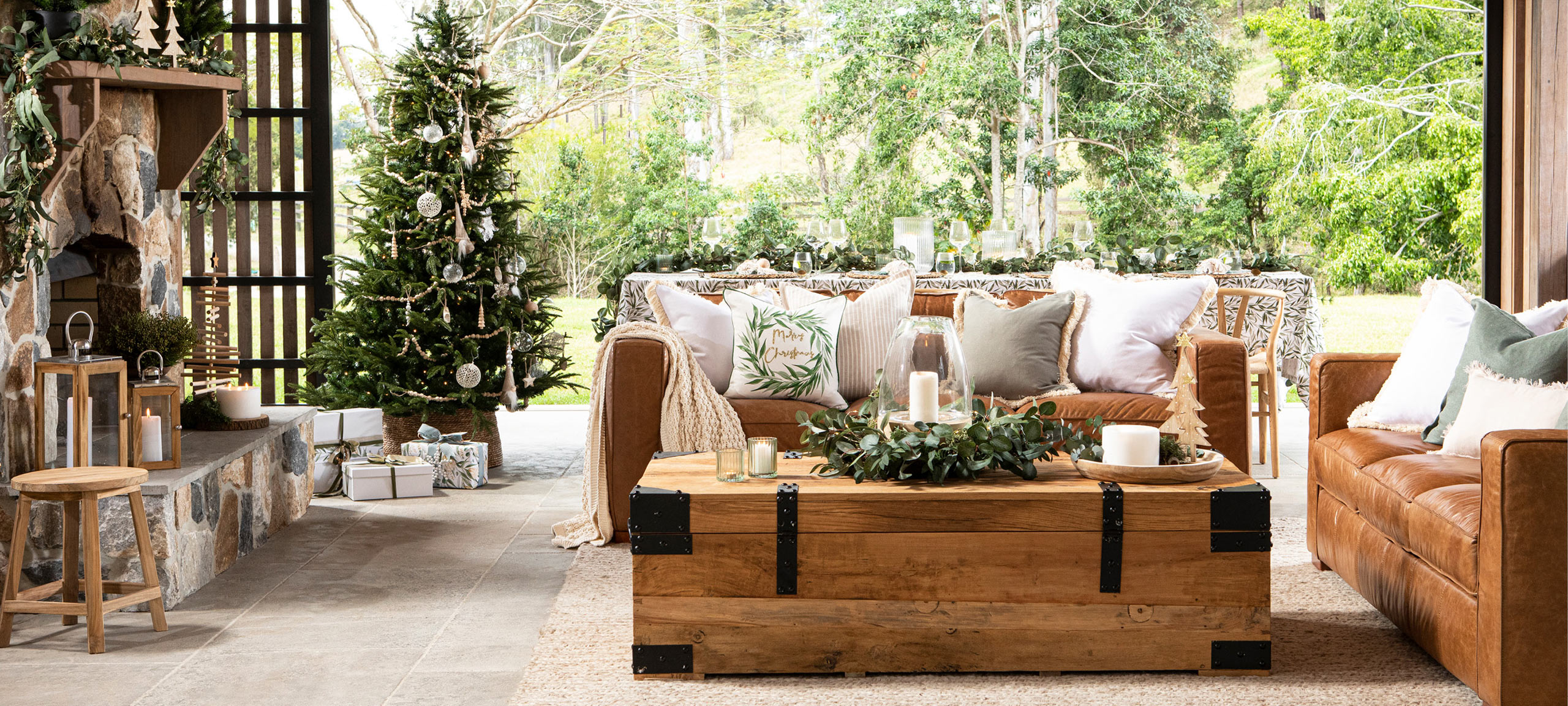 Christmas styled room with tree and cushions
